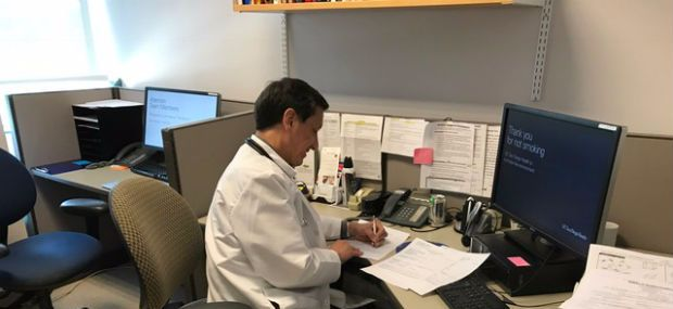 Dr. Jairo Romero at work in the Geriatrics clinic